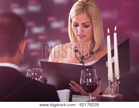Young Woman Choosing Menu