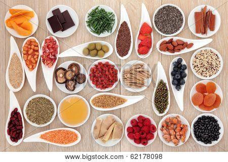 Healthy super food selection over oak wood background