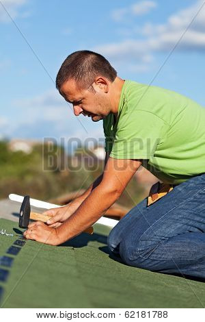 Man On The Roof Fastening Bitumen Roof Shingles