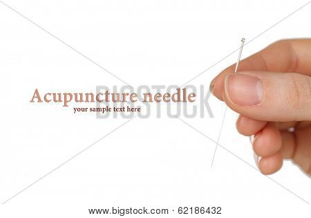 Hand holding needle for acupuncture isolated on white