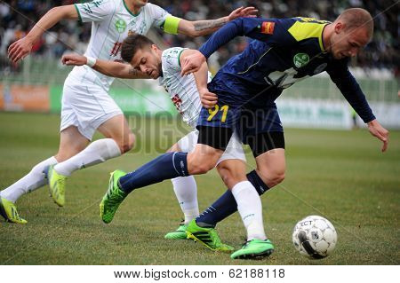 KAPOSVAR, HUNGARY - MARCH 16: Gergo Vaszicsku (blue 91) in action at a Hungarian Championship soccer game - Kaposvar (white) vs Puskas Akademia (blue) on March 16, 2014 in Kaposvar, Hungary.
