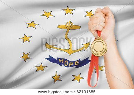 Medal In Hand With Flag On Background - State Of Rhode Island And Providence Plantations. Part Of A