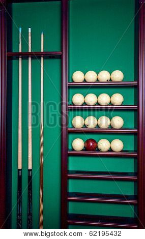 Billiard stand with cues