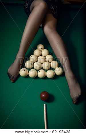 Billiard ball aiming at sexy women legs
