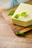 foto of margarine  - Tasty butter on wooden cutting board - JPG