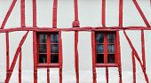 White and red half-timbered house detail