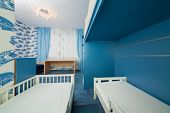 stock photo of bunk-bed  - Beautiful modern children bedroom with wallpapers with cars - JPG