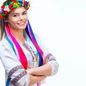 image of national costume  - young happy woman  in the national Ukrainian costume on a white background - JPG