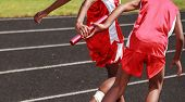 stock photo of relay  - Passing the baton in a relay race - JPG