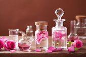 stock photo of flask  - alchemy and aromatherapy set with rose flowers and flasks - JPG