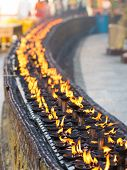 pic of yangon  - Burning oil lamps at the Shwedagon Pagoda in Yangon the capital of Republic of the Union of Myanmar - JPG