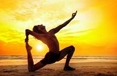 image of mudra  - Man doing Yoga on the beach near the ocean in India - JPG
