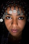 Closeup of a beautiful African woman wearing a Moroccan headdress