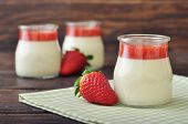 picture of panna  - Dessert panna cotta with fresh strawberry on wooden background - JPG