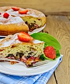 pic of sorrel  - Piece of sweet cake with strawberries and sorrel on a wooden table