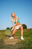 stock photo of badminton player  - badminton player in action  - JPG