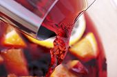 stock photo of sangria  - Runnung red wine cooking process of Sangria - JPG
