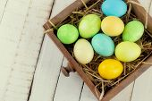 picture of nesting box  - Easter eggs on wooden background - JPG