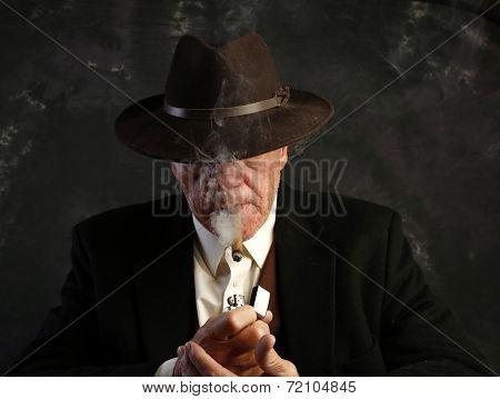 Man with lighted cigar & smoke