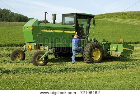 Farmer And Haybine