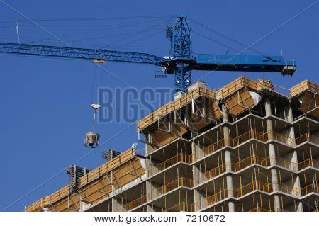 Construction crane with concrete bucket