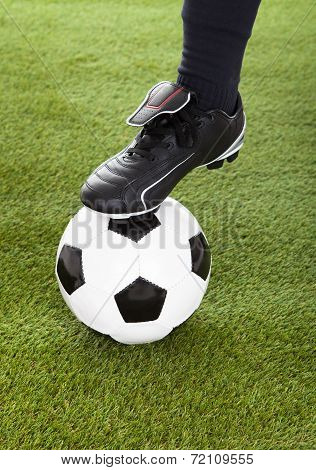 Low Section Of Player's Leg On Soccer Ball