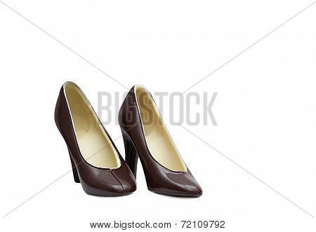 Tasty shoes of dark chocolate, isolated on white