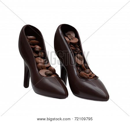 Chocolate shoes filled with coffee beans