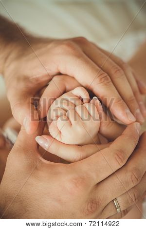 Baby feet in mommy's hands
