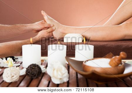 Therapist Massaging Customer's Foot At Beauty Spa