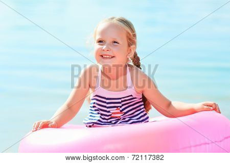 happy laughing girl and swim ring