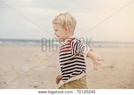 happy kid running on the sea beach