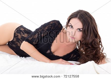 Young Sexy Woman In Black Lace Lingerie Lying On Bed Isolated On White