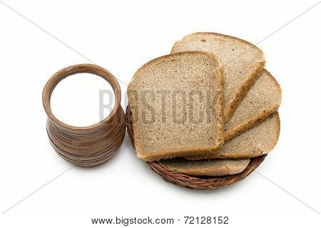 Earthenware Mug With Milk And Bread On White Background