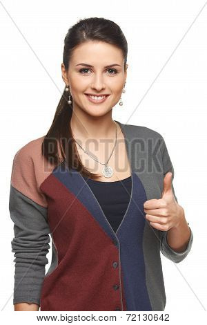 Woman in cardigan gesturing thumb up