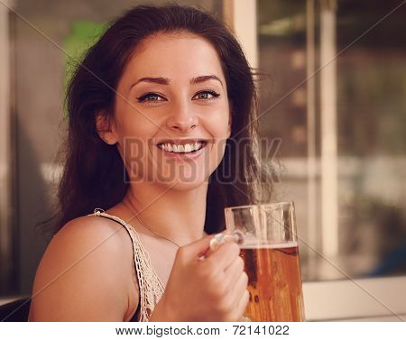 Happy Woman Drinking Beer In Pab. Closeup Vintage Portrait