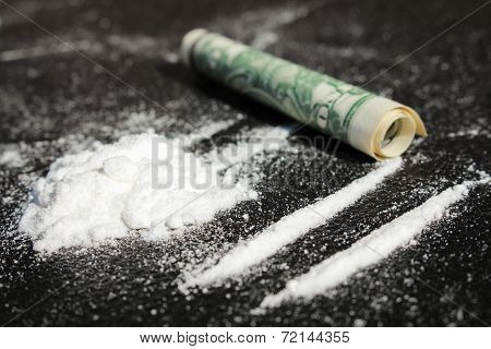 Lines of cocaine and one dollar bill