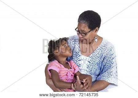 Grandmother and granddaughter bonding together isolated on a white background