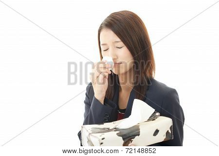 Sneezing woman having cold.