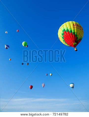 Bunch of colored balloons in blue sky