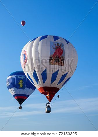 Three colored balloons in blue sky