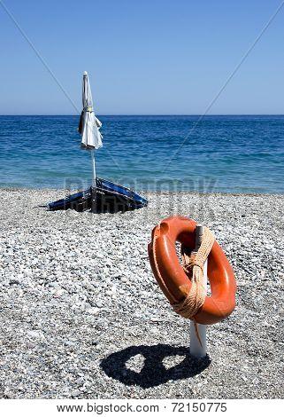 stil-life with lifebuoy and beach umbrella
