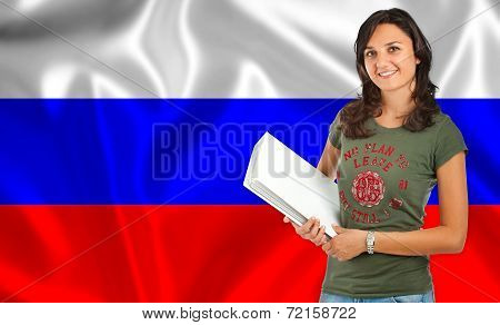 Student Smiling Over Russian Flag