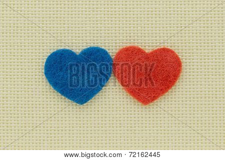 Blue And Red Hearts On A Light Background
