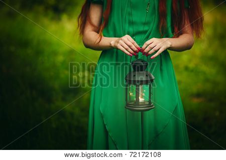 Woman Holding Lantern With Candle