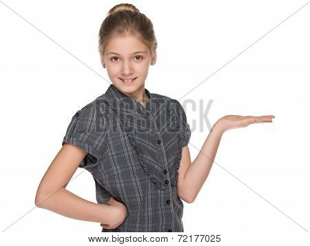 Smiling Preteen Girl Makes A Hand Gesture