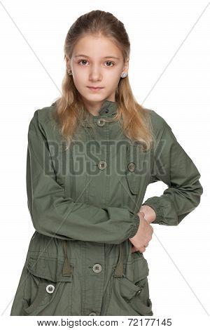 Pensive Preteen Girl In The Coat