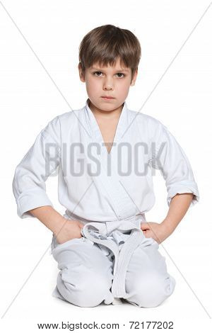 Little Boy In Gi Sits On The Floor