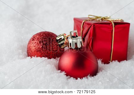 Red Christmas Decorations In Snow