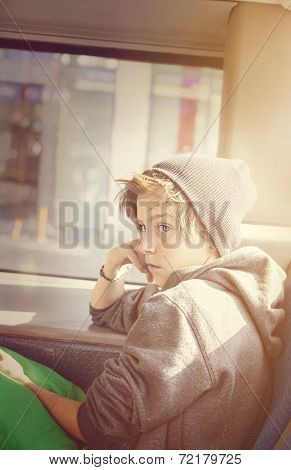 Portrait Of A Teenager Boy With Toque, Sitting In A Bus